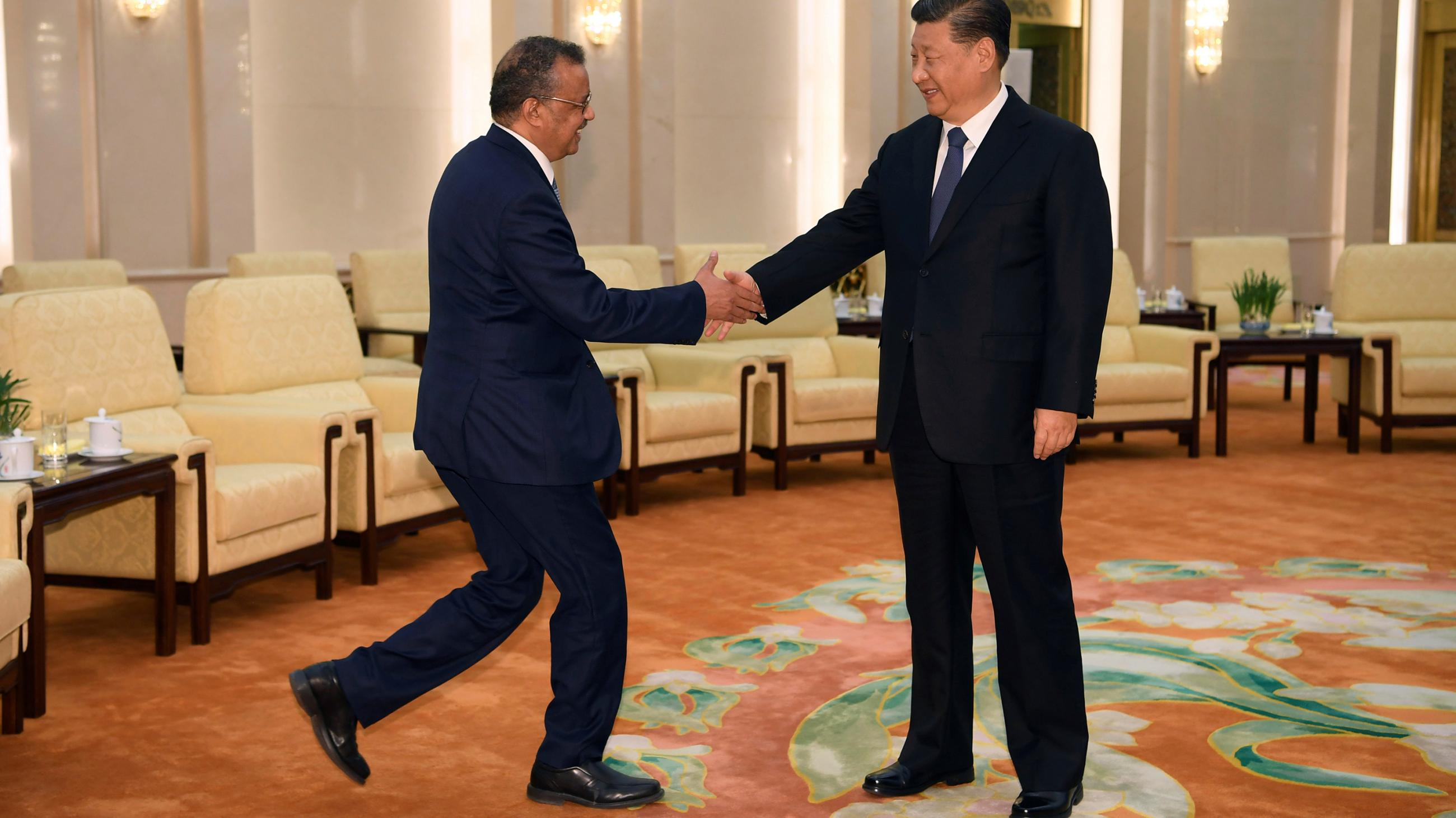 The photo shows the two leaders shaking hands and smiling.