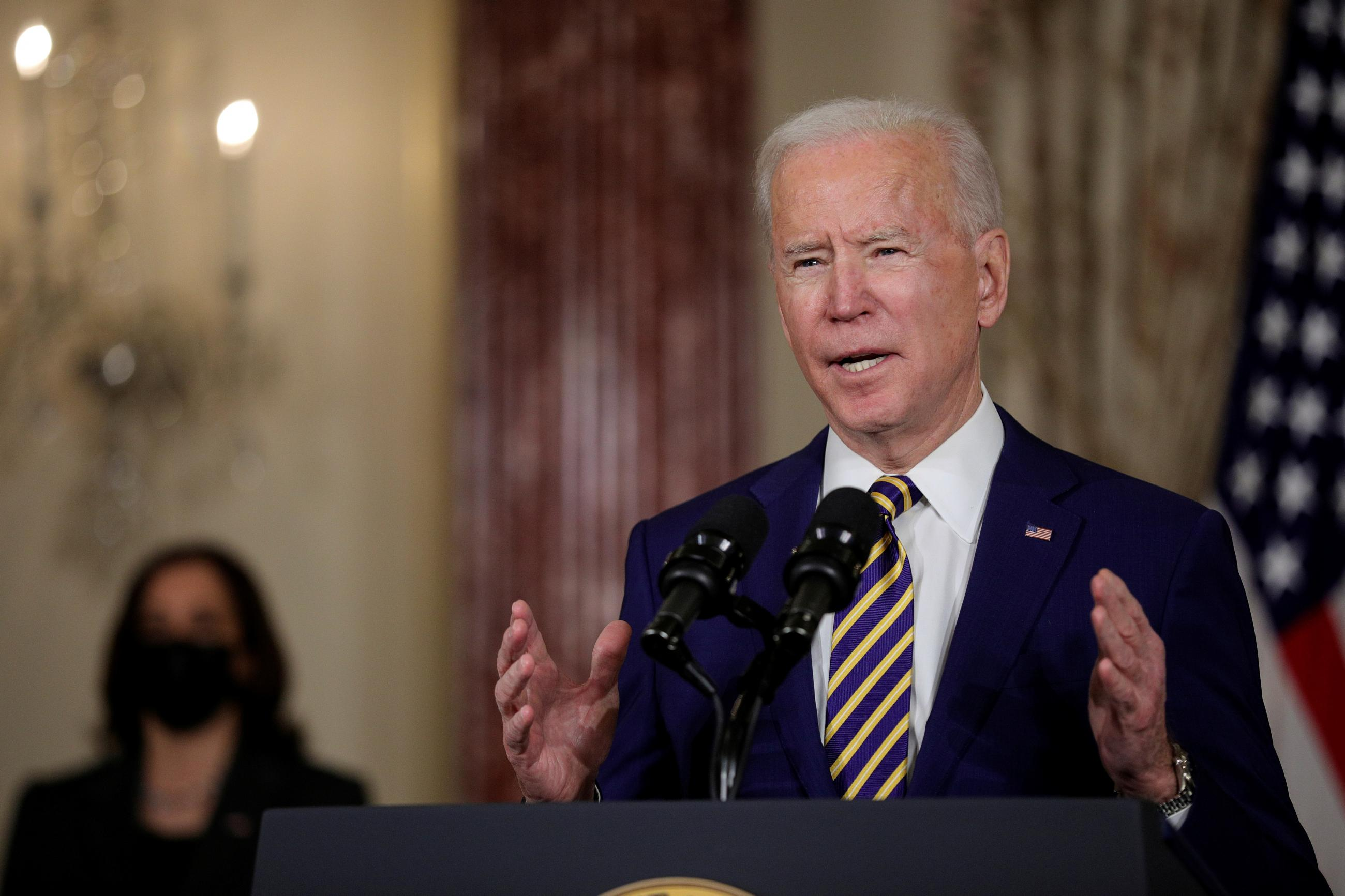 U.S. President Joe Biden delivers a foreign policy address as Vice President Kamala Harris listens, at the State Department in Washington, DC on February 4, 2021.