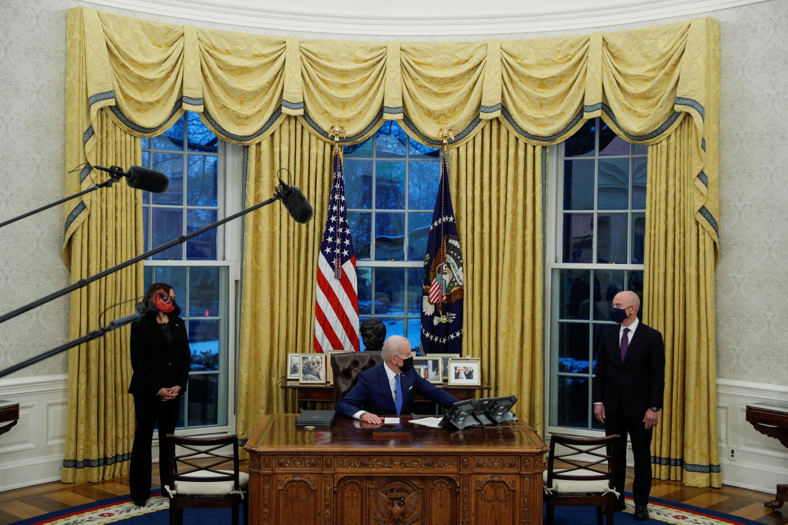 U.S. President Joe Biden looks on as he prepares to sign executive orders at the White House in Washington, U.S., February 2, 2021.