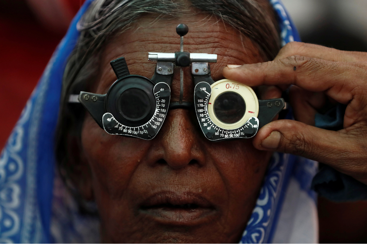 A woman gets her eyes tested at a free eye-care camp in Mumbai, India on December 6, 2019.