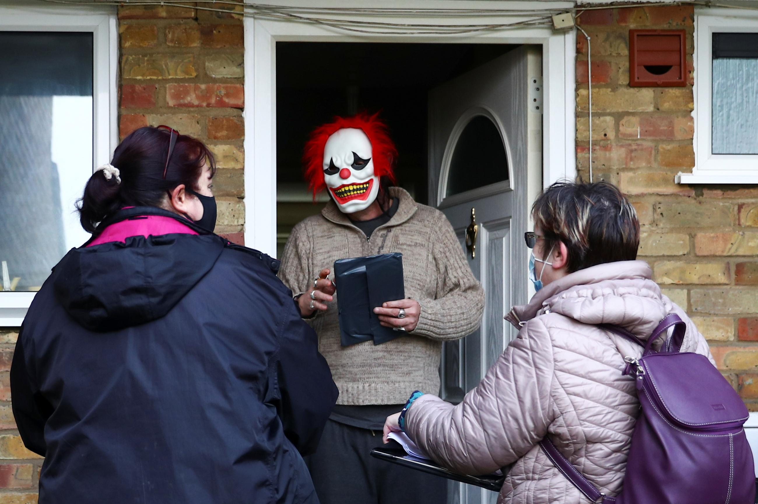 Volunteers hand out the COVID-19 home test kits to residents, in Goldsworth and St Johns, amid the outbreak of coronavirus disease (COVID-19) in Woking, Britain, February 2, 2021.