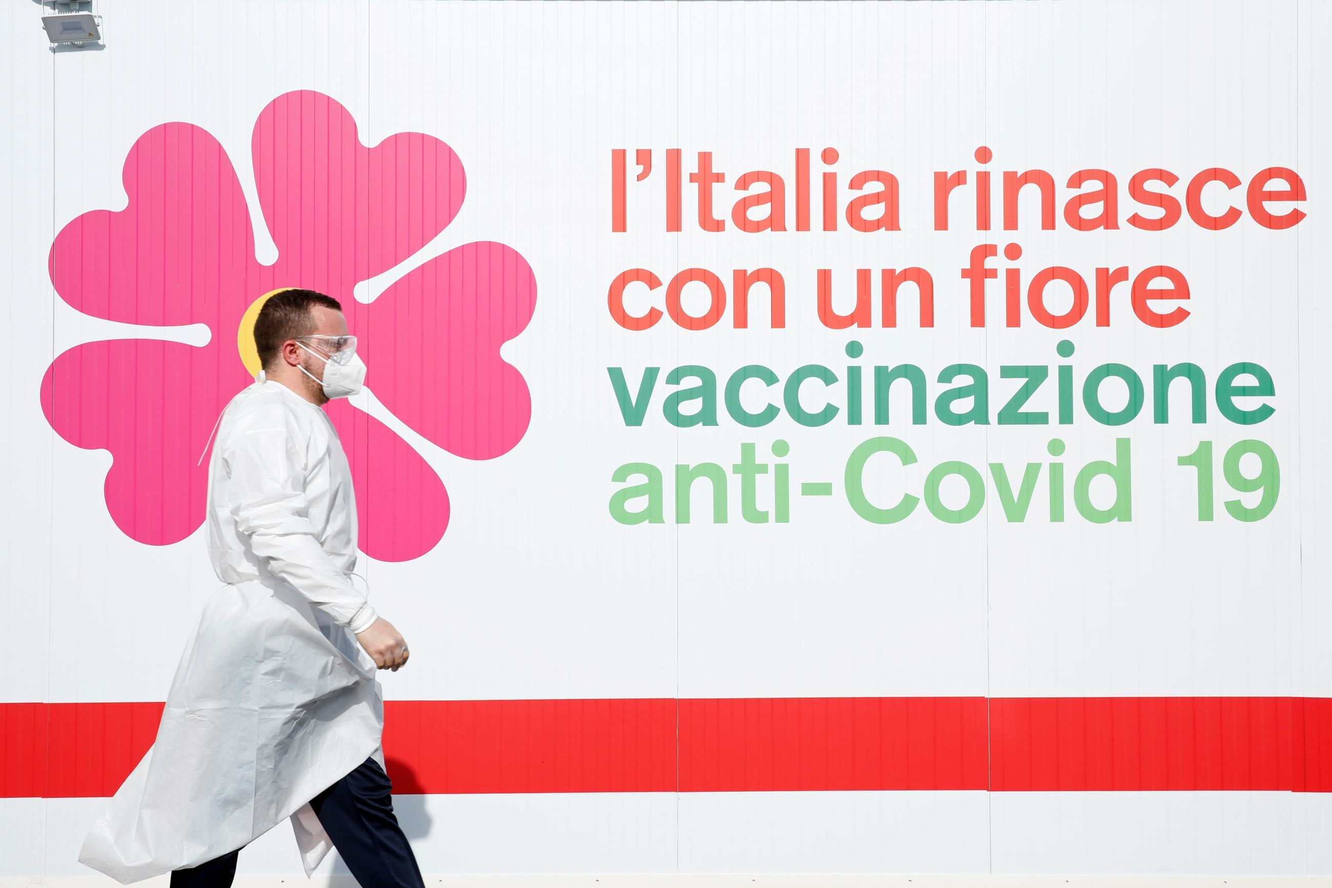 A man walks outside a tent during preparations to turn the long-term car park at Fiumicino airport into a coronavirus disease (COVID-19) vaccination centre, in Rome, Italy, February 5, 2021.