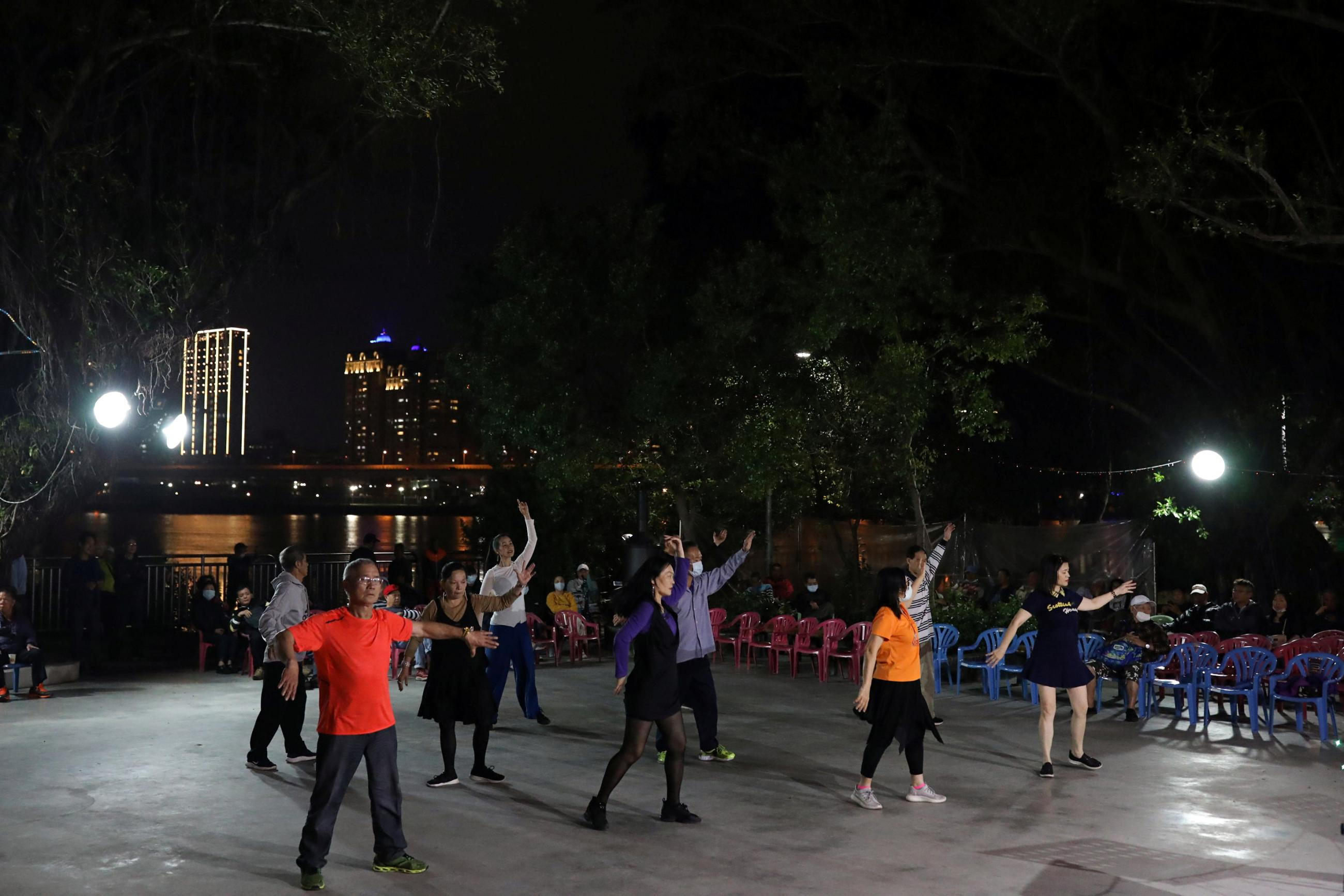 People dance to the music at a temple in Taipei, Taiwan on March 24, 2020.