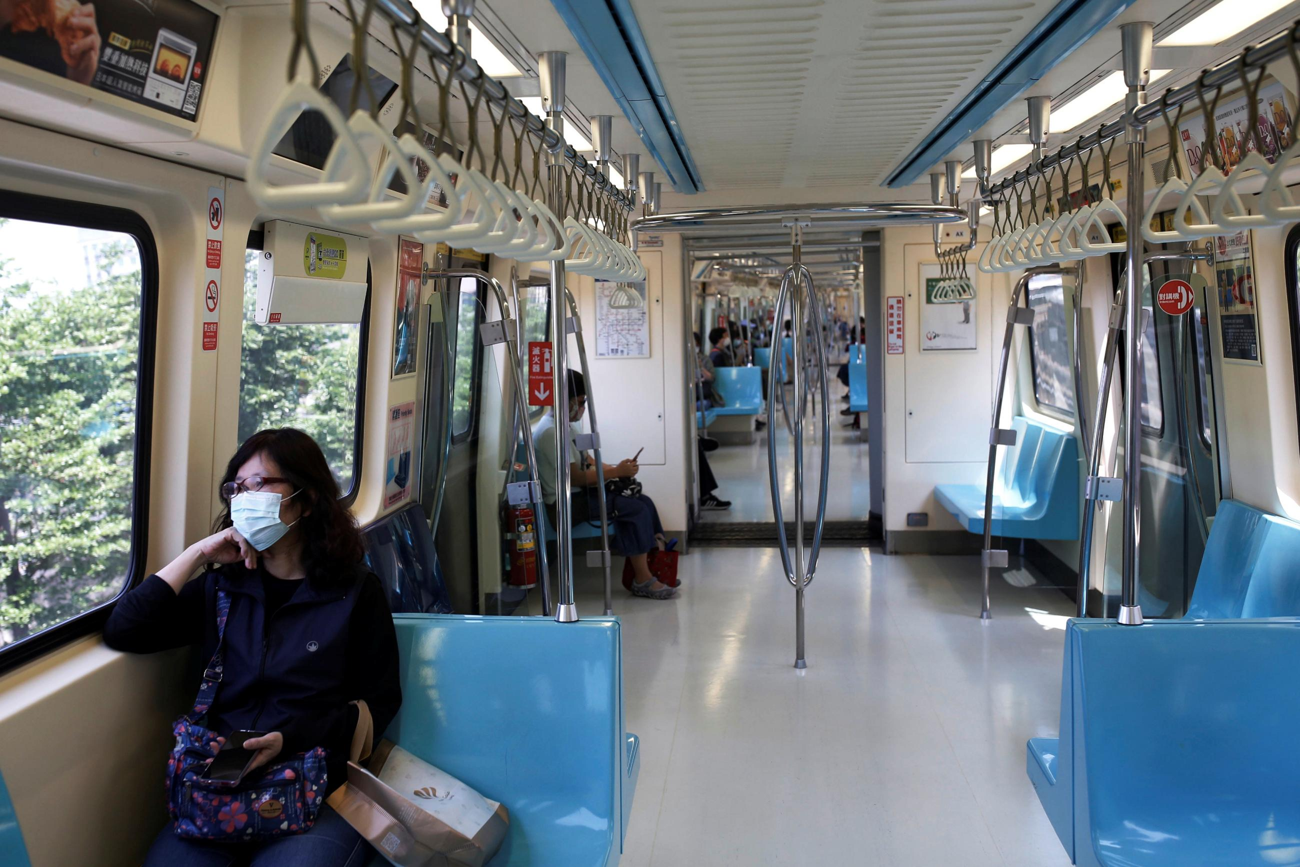 A woman wears a face mask as a mandatory precaution for riding on public transportation amid the coronavirus disease (COVID-19) outbreak, in Taipei, Taiwan, April 30, 2020.