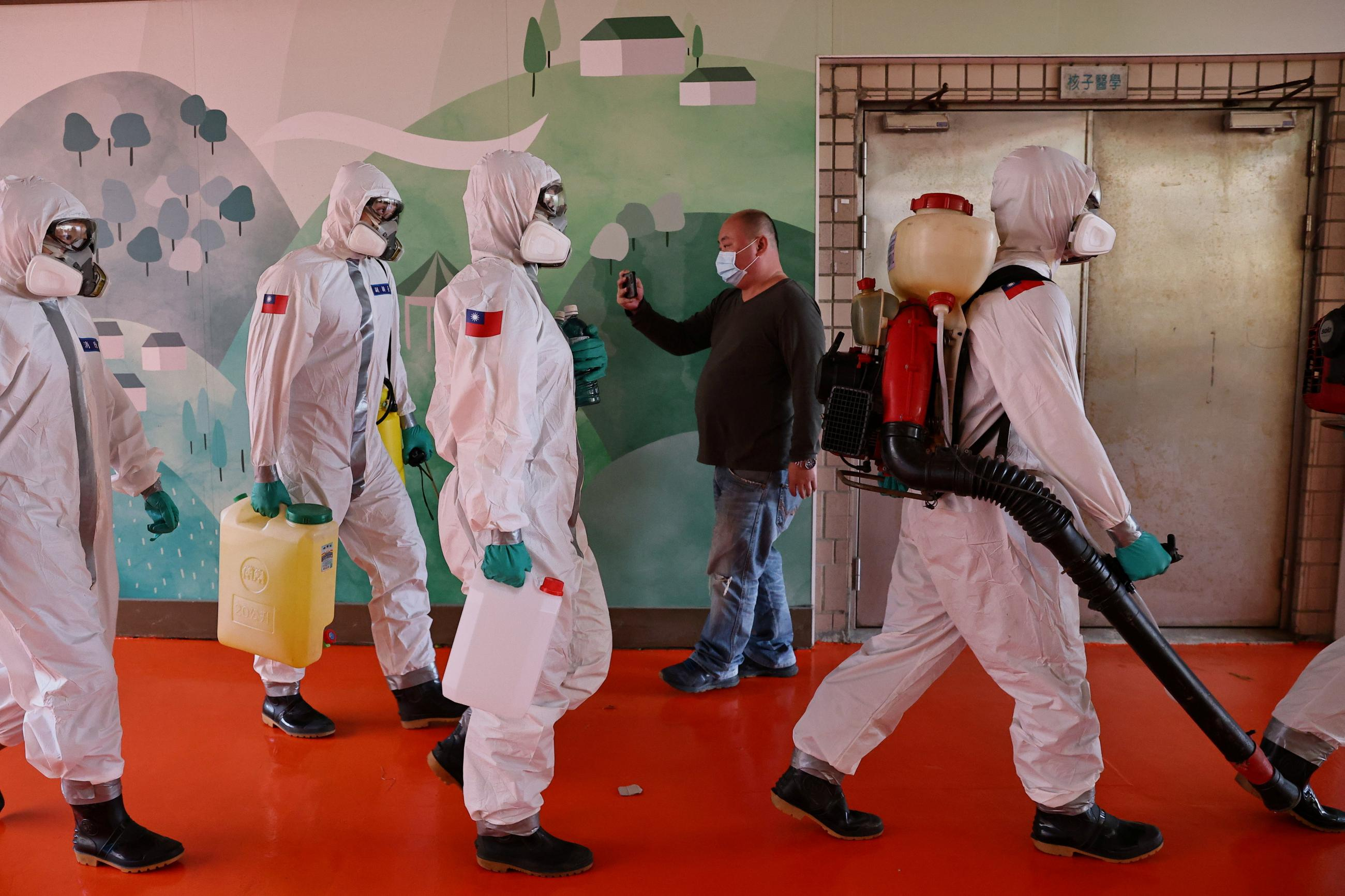 Soldiers prepare to spray disinfectant at the Taoyuan General Hospital, where a cluster of coronavirus disease (COVID-19) infections was detected, in Taoyuan, Taiwan, January 19, 2021.