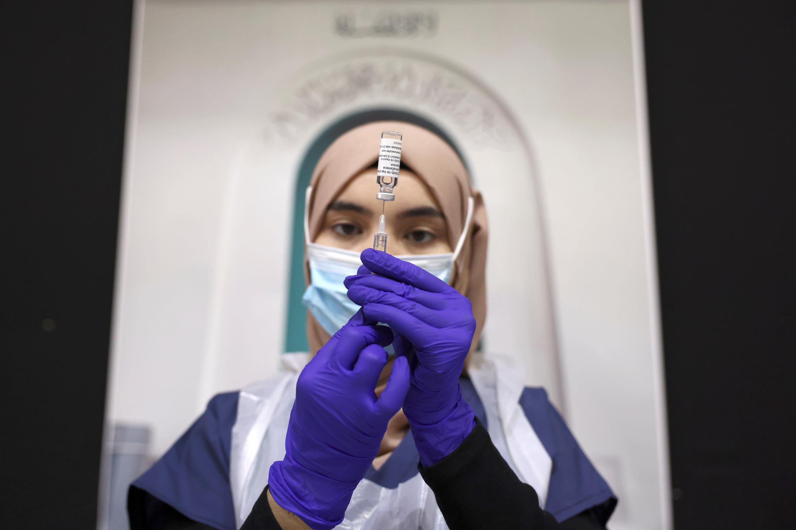 A medical worker prepares an injection with a dose of Astra Zeneca coronavirus vaccine, at a vaccination centre in Baitul Futuh Mosque, amid the outbreak of coronavirus disease (COVID-19), in London, Britain, March 28, 2021