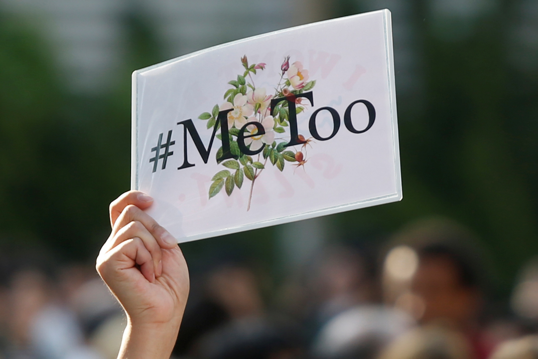 A protester raises a #MeToo sign during a rally against harassment at Shinjuku shopping and amusement district in Tokyo, Japan on April 28, 2018. REUTERS/Issei Kato