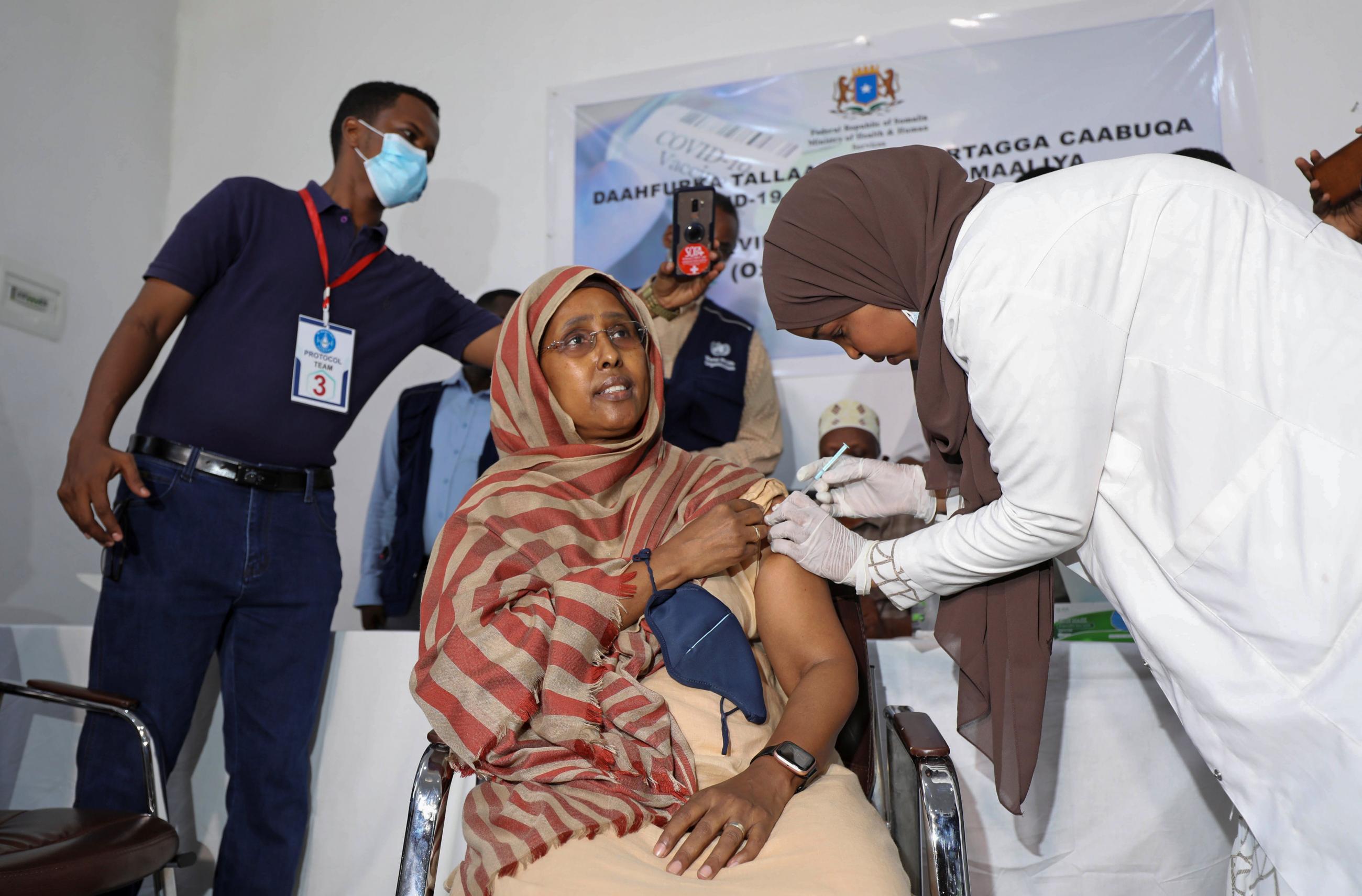 Somalia's health minister Fawziya Abikar Nur receives the AstraZeneca/Oxford vaccine (supplied via COVAX) at the Martini Hospital in Mogadishu, Somalia on March 16, 2021. REUTERS/Feisal Omar