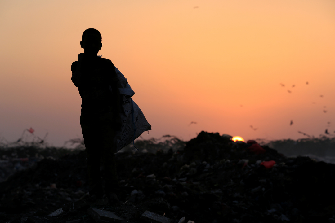 A boy stands in a garbage dump—where his family collects food to eat—near the Red Sea port city of Hodeidah, Yemen on January 13, 2018. REUTERS/Abduljabbar Zeyad