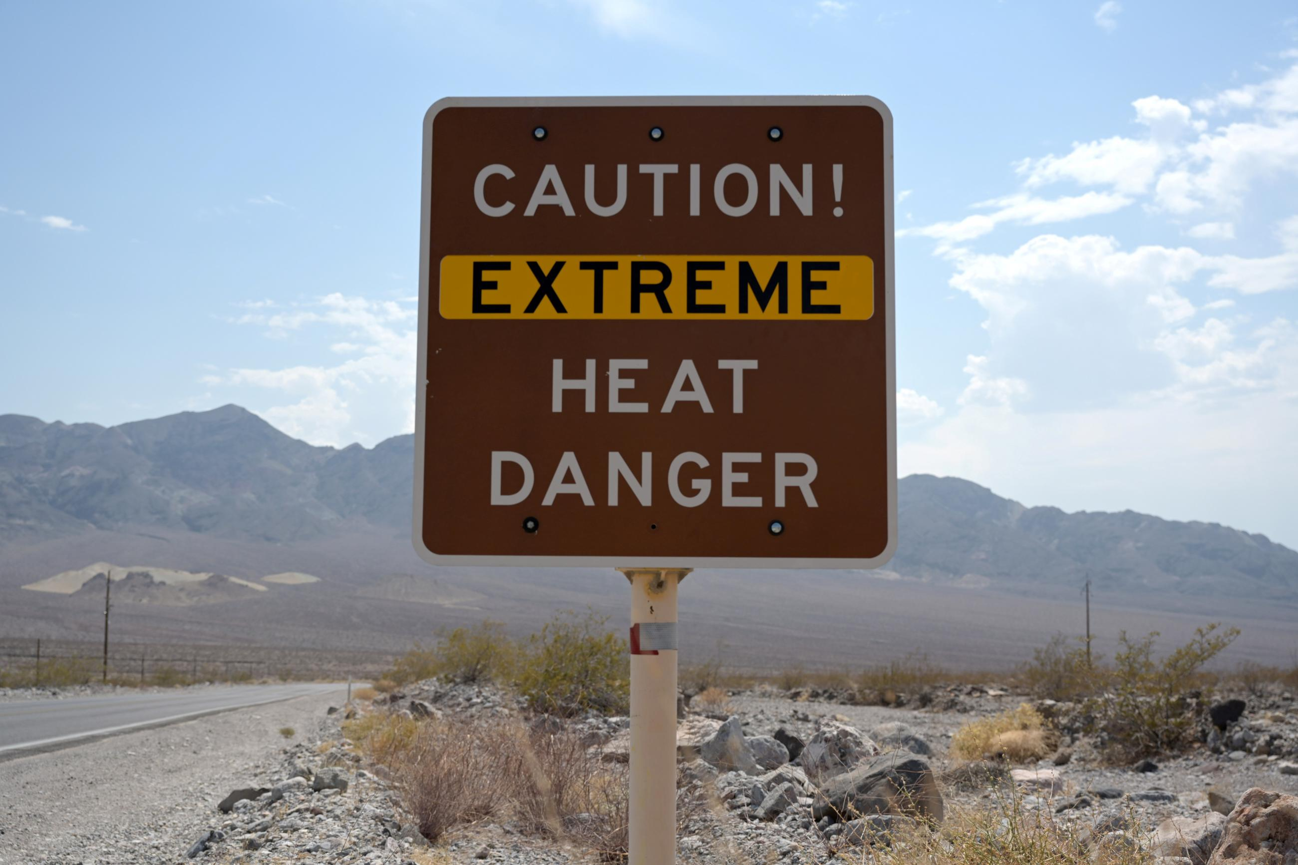 A sign warns of extreme heat in Death Valley, California, U.S., July 11, 2021