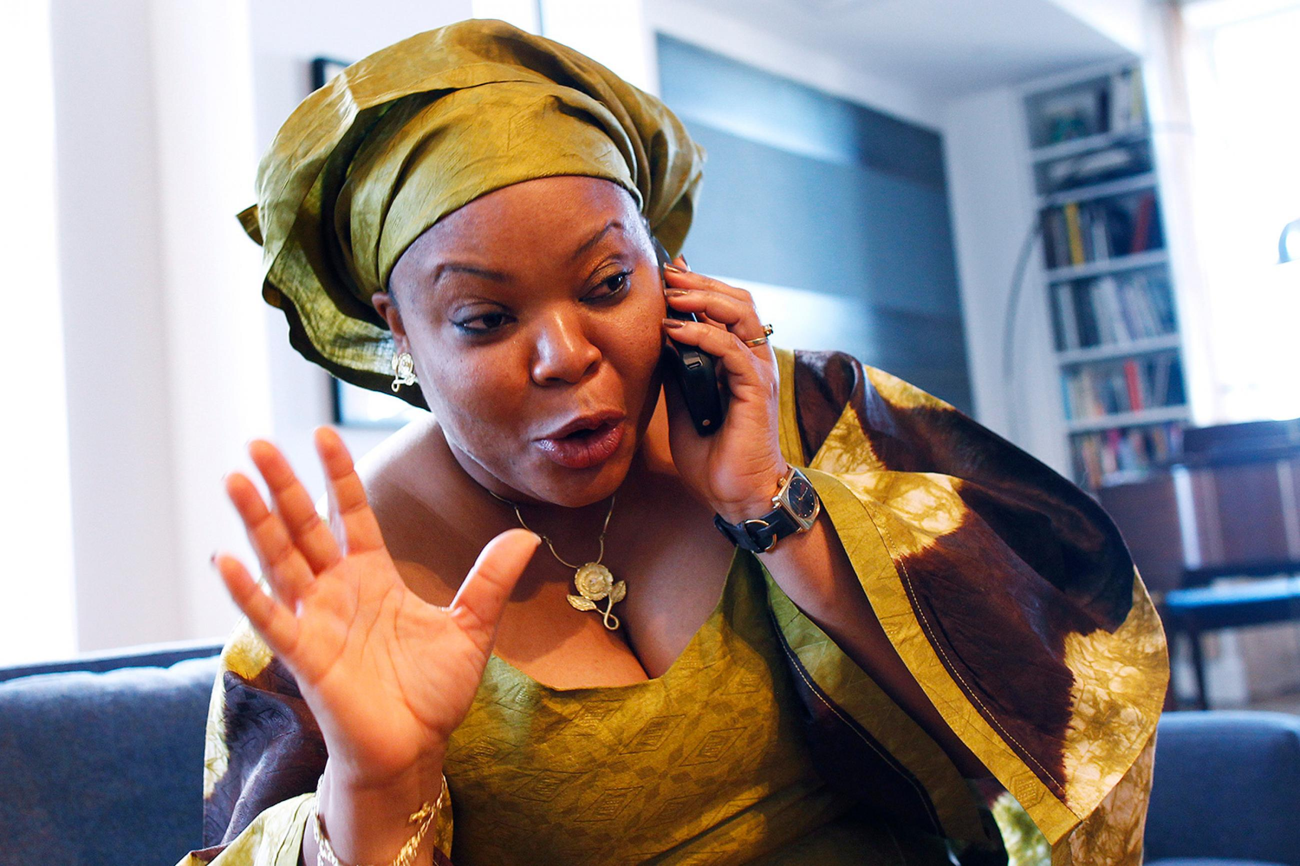Nobel Peace Prize winner Leymah Gbowee on a phone in New York on October 7, 2011. The efforts of Gbowee and other women to peace-building in Liberia was seen as critical to securing a lasting peace. The photo shows the nobel laureate in great spirits talking on the phone. REUTERS/Shannon Stapleton