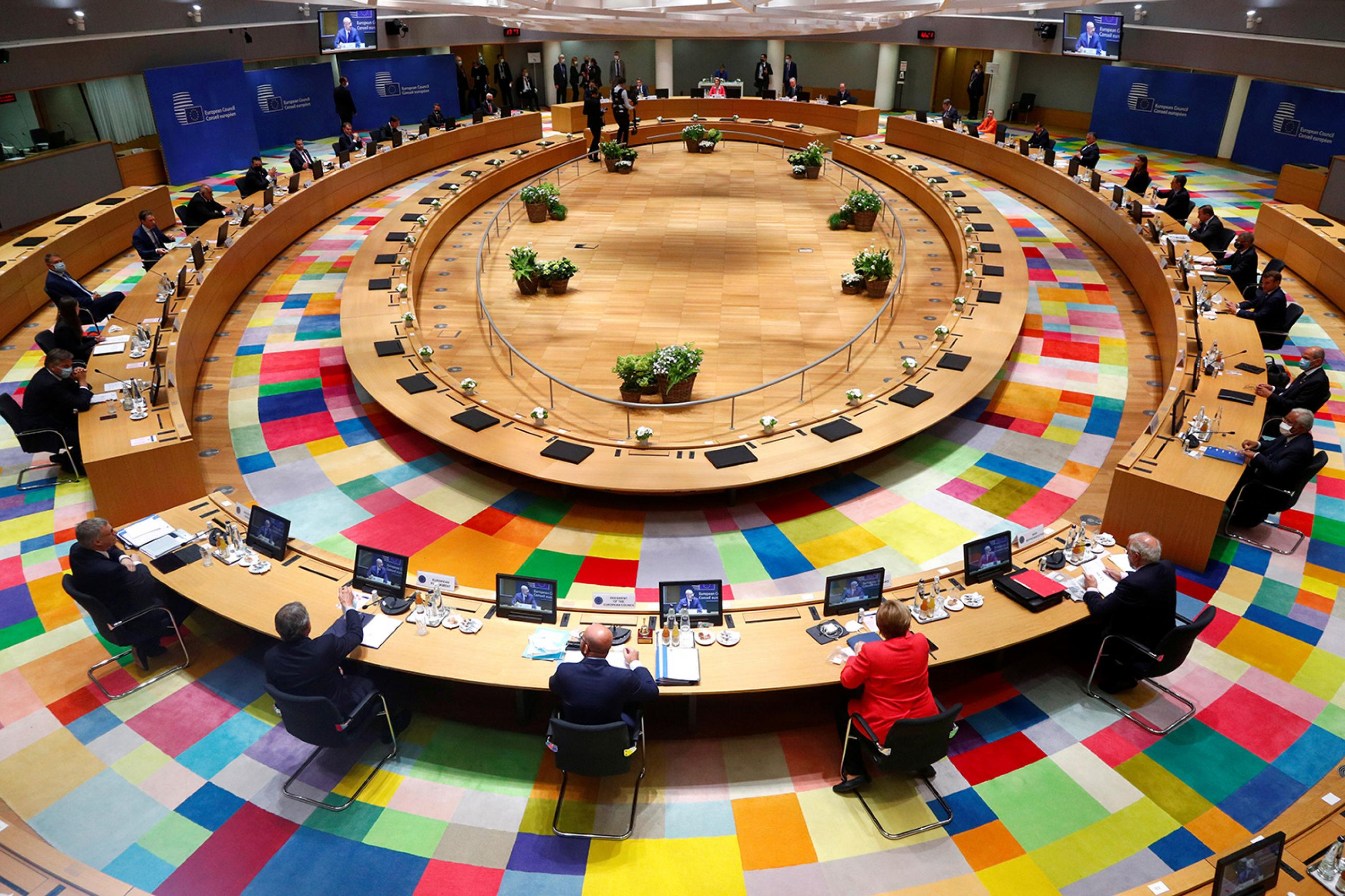 Where policy meets health: European Union leaders take part in the first face-to-face EU summit since the coronavirus disease (COVID-19) outbreak began, in Brussels, Belgium, on July 17, 2020. The photo shows a large round table from above with various leaders seated far apart from one another. REUTERS/Francois Lenoir