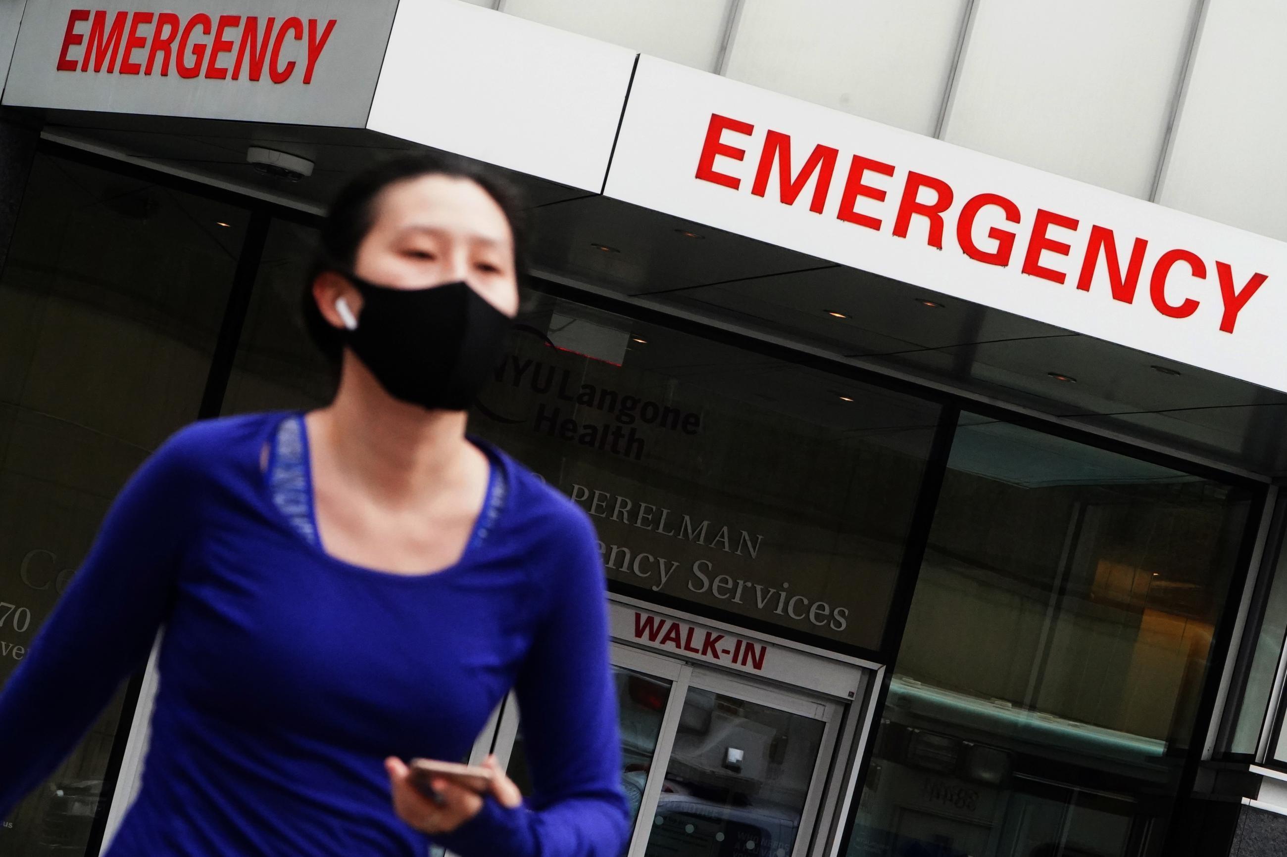 A woman walks away from a hospital emergency department amid the coronavirus disease (COVID-19) pandemic in the Manhattan borough of New York City, New York, U.S., December 24, 2020