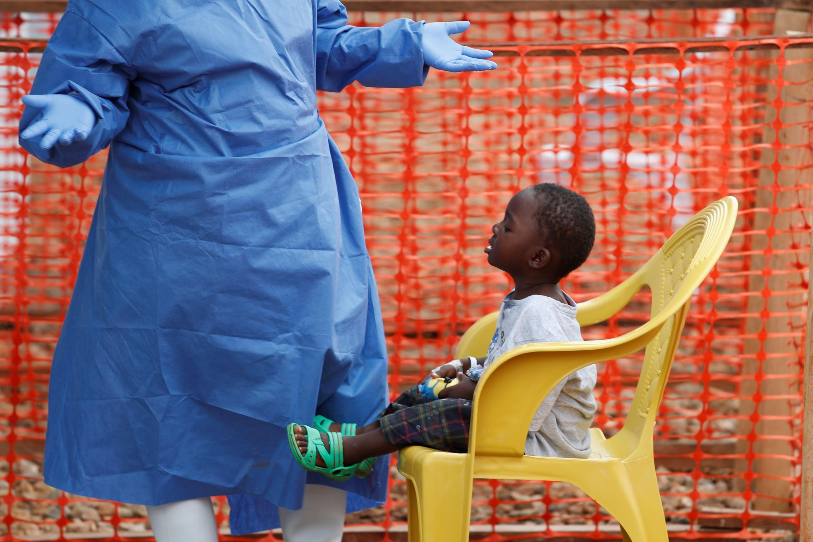 An Ebola survivor plays with a boy suspected of being infected with Ebola virus in a transit centre in Beni, North Kivu Province of Democratic Republic of Congo, December 15, 2018.