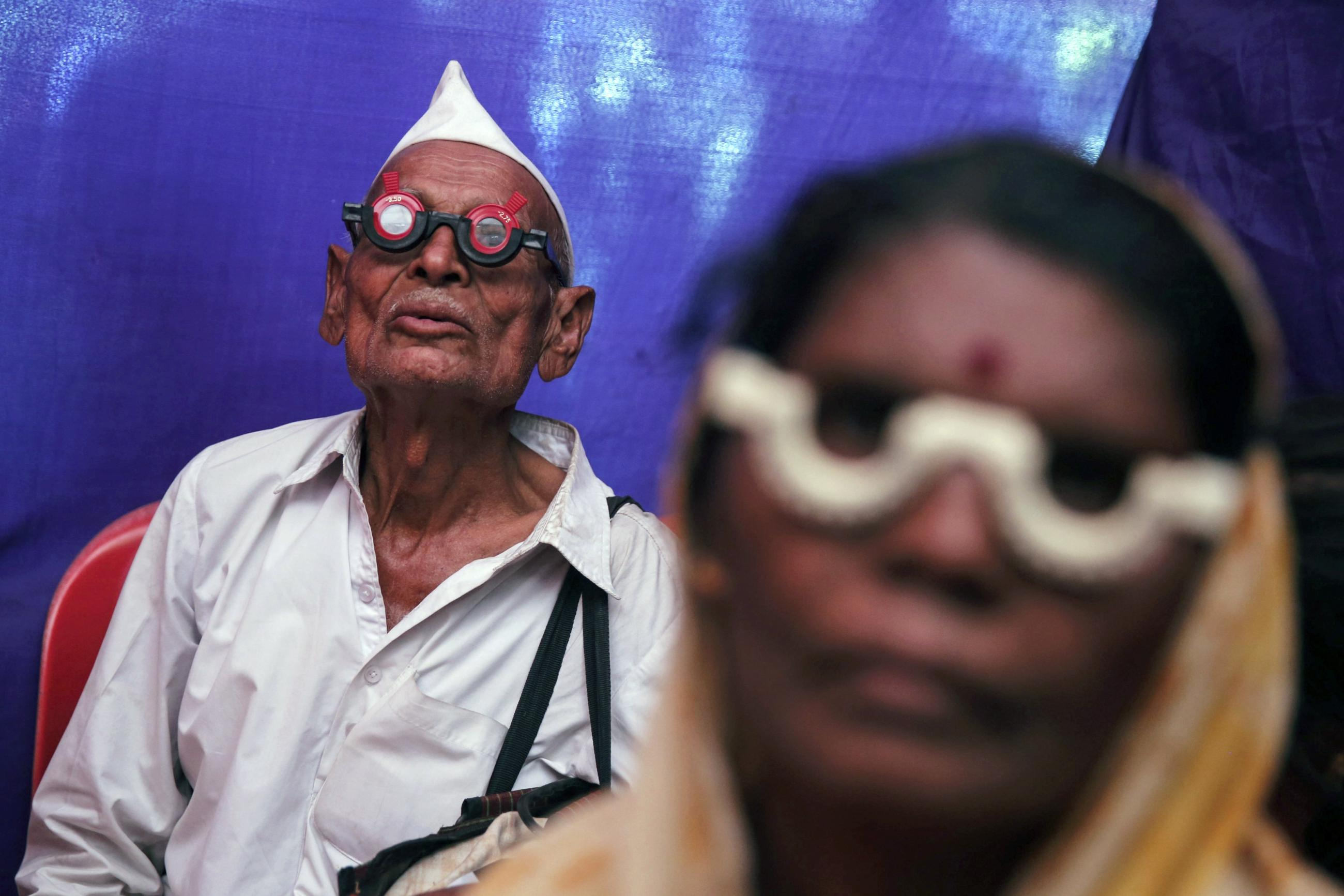 People get their eyes tested at a free eye-care camp, in Mumbai, India, on December 6, 2014.