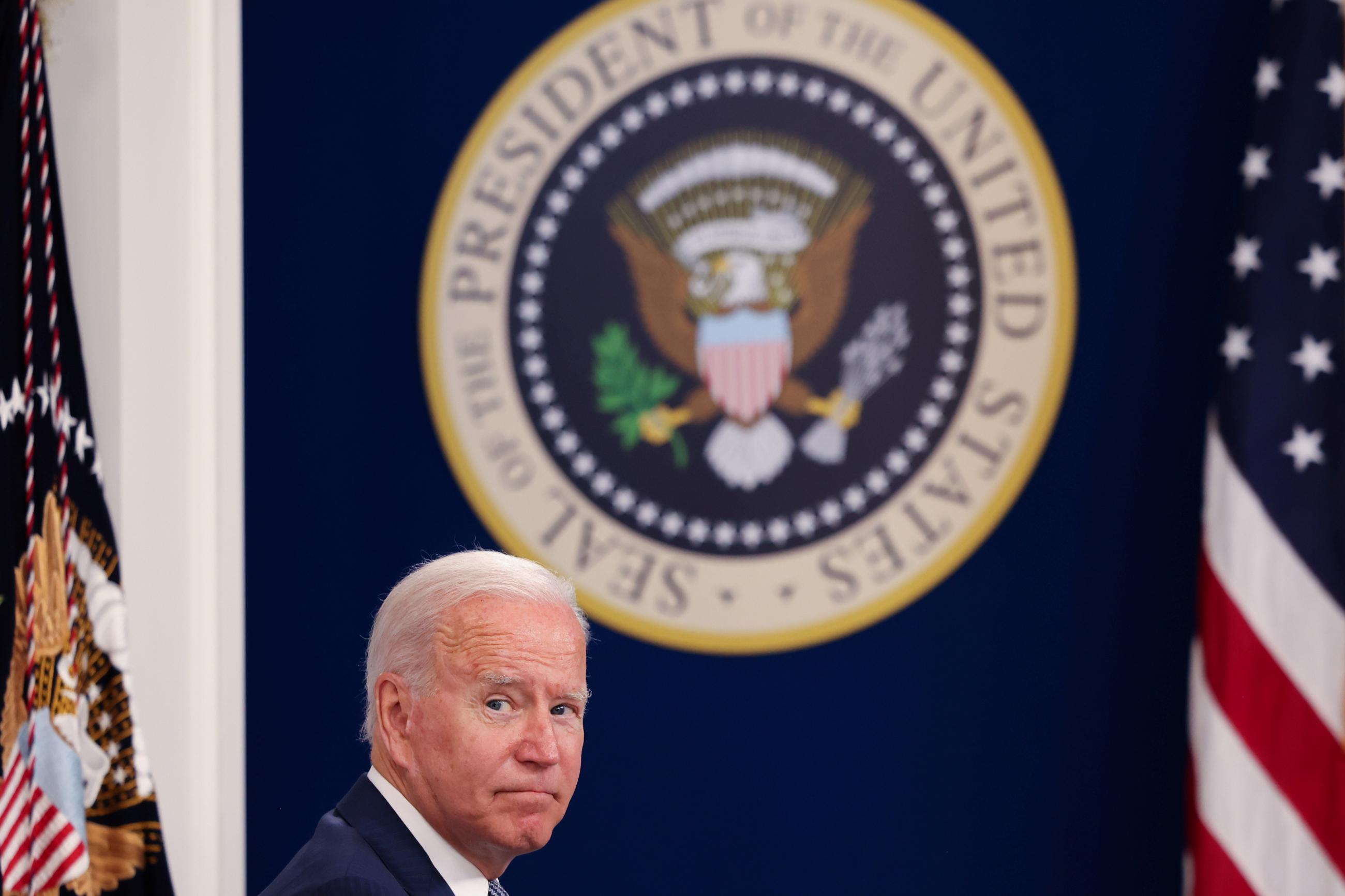 U.S. President Joe Biden sits in front of a large UShosts a virtual COVID Summit from the White House in Washington, DC, on September 22, 2021.