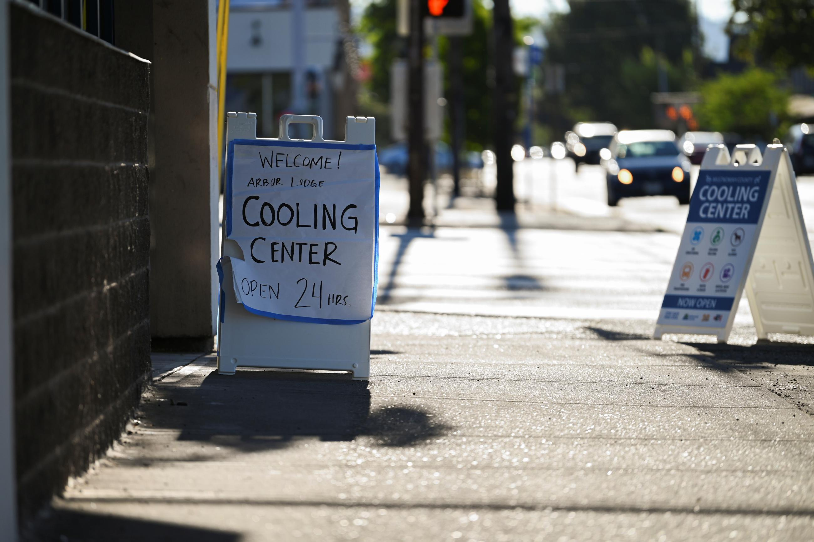 A sign sits outside of a cooling shelter during a heat wave in Portland, Oregon, U.S., August 11, 2021.
