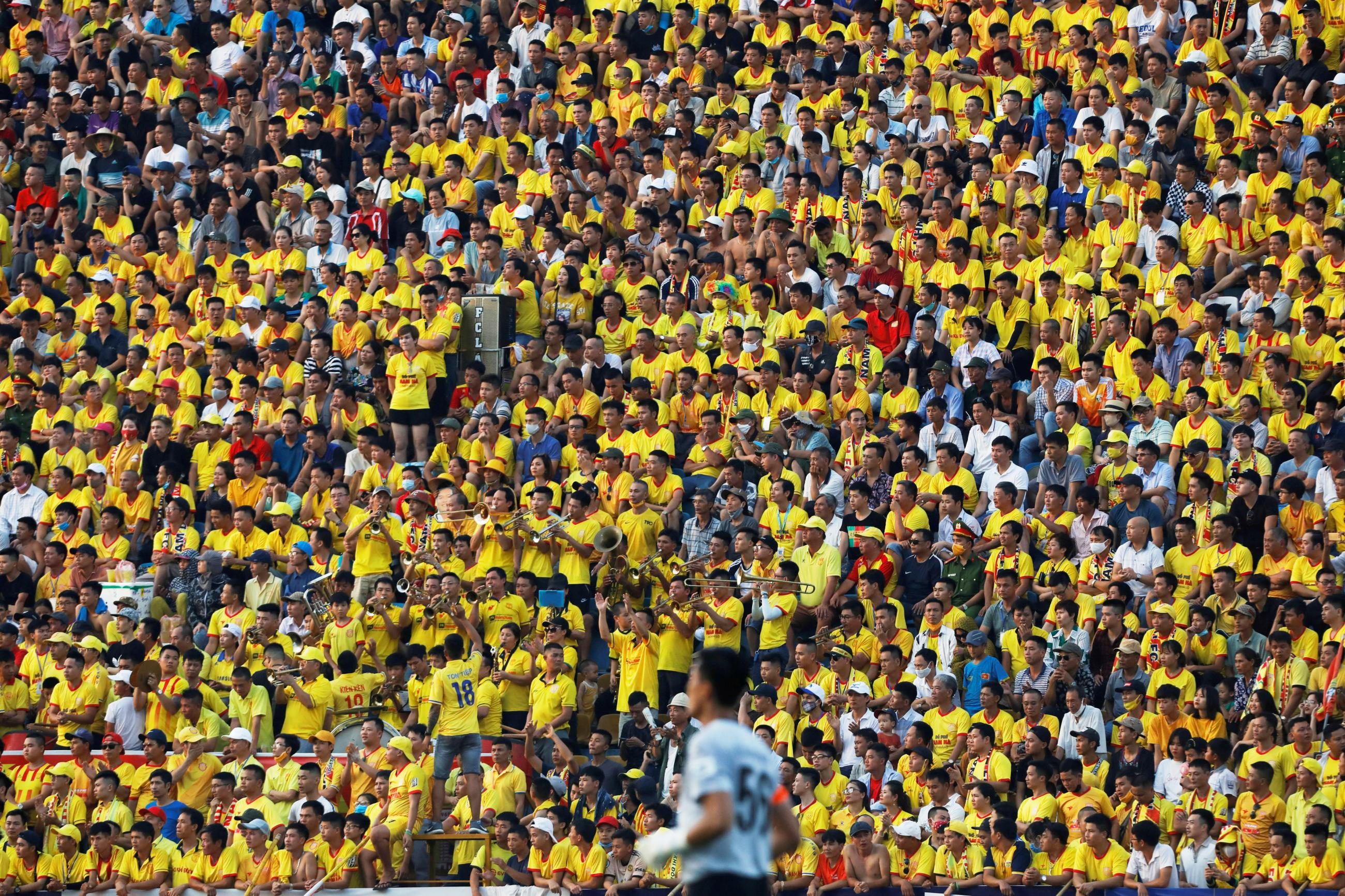 Soccer fans attend a match between Viettel and Duoc Nam Ha Nam Dinh of Vietnam's national soccer league after an outbreak and nationwide COVID-19 lockdown, in Nam Dinh province, Vietnam, on June 5, 2020.