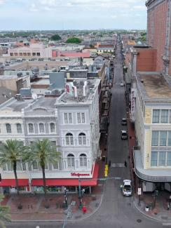 The photo shows a view of the entrance to Bourbon street, which would normally be packed with tourists and other people, almost completely empty.