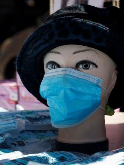 The photo shows a mannequin wearing a blue mask.