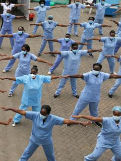 The photo shows a field of nurses exercising in a field.