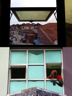 Photo is a split screen showing the photographer leaning out the window taking a picture and also a shot from inside looking out at what he was seeing.