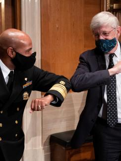 U.S. Surgeon General Jerome Adams and National Institutes of Health (NIH) Director Francis Collins bump elbows after testifying before the Senate Health, Education, Labor and Pensions Committee hearing to discuss about vaccines and protecting public health during the coronavirus disease (COVID-19) pandemic, in Washington, U.S., September 9, 2020.
