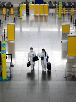 Passengers wearing hazmat suits for protection against the coronavirus disease walk inside the Ninoy Aquino International Airport in Paranaque, Metro Manila, Philippines on January 14, 2021.
