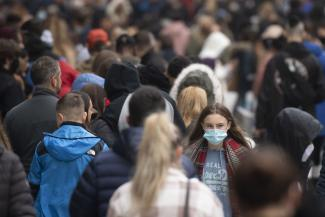 A woman wears a face mask on a busy Queen Street in Cardiff, Wales, United Kingdom on November 21, 2020.