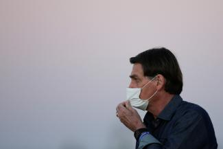 President Jair Bolsonaro is seen during a ceremony to lower the Brazilian National flag down for the night, at the Alvorada Palace, amid the coronavirus disease  outbreak, in Brasilia, Brazil on  July 15, 2020.