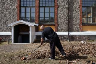 An inmate sentenced to ten months rakes leaves in Bastøy Prison in Horten, Norway on April 11, 2011.