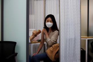 A health worker gets a dose of the Pfizer-BioNTech coronavirus disease (COVID-19) vaccine at a COVID-19 vaccination center in Seoul, South Korea, March 10, 2021.